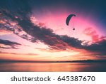 paraglide silhouette in a light ... | Shutterstock . vector #645387670
