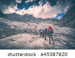 group of hikers with backpacks... | Shutterstock . vector #645387820
