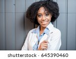 portrait of a young african... | Shutterstock . vector #645390460