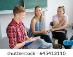smiling diverse young students... | Shutterstock . vector #645413110