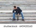 man depressed with wine bottle... | Shutterstock . vector #645420163