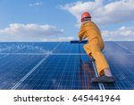 labor working on cleaning solar ... | Shutterstock . vector #645441964