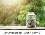 money saving  coin in glass jar....   Shutterstock . vector #645445948