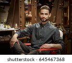 portrait of a barber.... | Shutterstock . vector #645467368