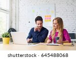 web designers working at office ...   Shutterstock . vector #645488068