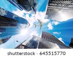 airplane flying over business... | Shutterstock . vector #645515770