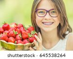 cute little girl with bowl full ... | Shutterstock . vector #645538264