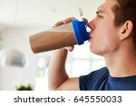 man drinking protein shake in... | Shutterstock . vector #645550033