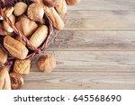 freshly baked bread on wooden... | Shutterstock . vector #645568690