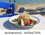 greek salad served by the sea ... | Shutterstock . vector #645667354