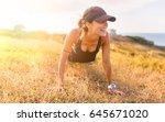 pretty fitness woman training... | Shutterstock . vector #645671020