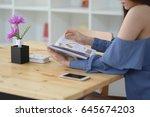 teen girl reading book with... | Shutterstock . vector #645674203