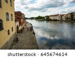 Small photo of Regensburg,Germany-May 20,2017:People saunter by the Danube on a sunny Saturday afternoon