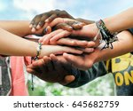 multiracial teenagers joining... | Shutterstock . vector #645682759