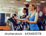 two young woman exercising on... | Shutterstock . vector #645683578