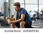 young man in gym sitting alone... | Shutterstock . vector #645685930