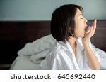 girl gapes   closeup sleepy... | Shutterstock . vector #645692440