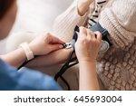 precise focused doctor... | Shutterstock . vector #645693004