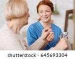 diligent nurse making sure her...   Shutterstock . vector #645693304