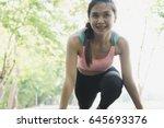 breathless sportswoman athletic ... | Shutterstock . vector #645693376
