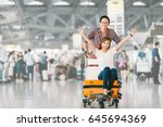 young asian tourist couple... | Shutterstock . vector #645694369