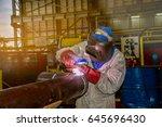 welder worker welding pipe in... | Shutterstock . vector #645696430