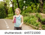 portrait of sporty smiling... | Shutterstock . vector #645721000