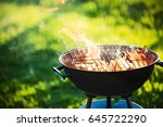 barbecue grill with fire on... | Shutterstock . vector #645722290