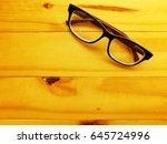 eyeglass on table | Shutterstock . vector #645724996