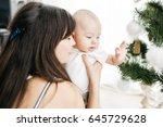the beautiful mother embarcing... | Shutterstock . vector #645729628