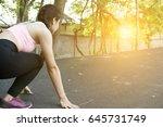 breathless sportswoman athletic ... | Shutterstock . vector #645731749