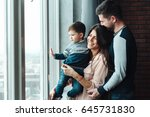 young parents with their sweet... | Shutterstock . vector #645731830