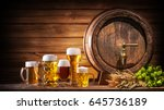 Stock photo oktoberfest beer barrel and beer glasses with wheat and hops on wooden table 645736189
