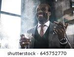 smiling african american... | Shutterstock . vector #645752770