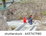 Small photo of Zrenjanin, Vojvodina, Serbia - July 01, 2015: Team of riggers is affix thermal protection on isolated pipeline, gas blowpipe torch heating for melting Styrofoam.