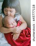 little sister hugging her... | Shutterstock . vector #645777118