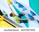 young athlete trying to resist... | Shutterstock . vector #645787450