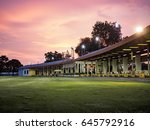 golf driving range with sunset | Shutterstock . vector #645792916