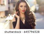 outdoor portrait of pretty... | Shutterstock . vector #645796528