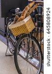 basket of bread on a vintage... | Shutterstock . vector #645808924