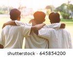 Three Man Hugging At Sunset...