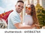 beautiful young couple enjoying ... | Shutterstock . vector #645863764