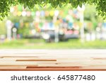 empty wooden table with party... | Shutterstock . vector #645877480