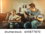 father teaching his son to play ... | Shutterstock . vector #645877870