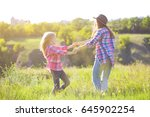 sister girls having fun in the... | Shutterstock . vector #645902254
