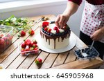 baker adding blueberries to a... | Shutterstock . vector #645905968
