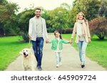 Stock photo family pet domestic animal and people concept happy family with labrador retriever dog walking 645909724