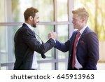 two businessmen standing... | Shutterstock . vector #645913963