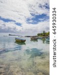Small photo of Mauritius - Bain Boeuf tropical beach with Coin de Mire Island in background