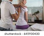woman having chiropractic back... | Shutterstock . vector #645930430
